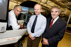 photograph - Three men and flight simulator