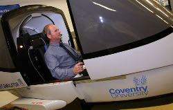 photograph - One man in a flight simulator